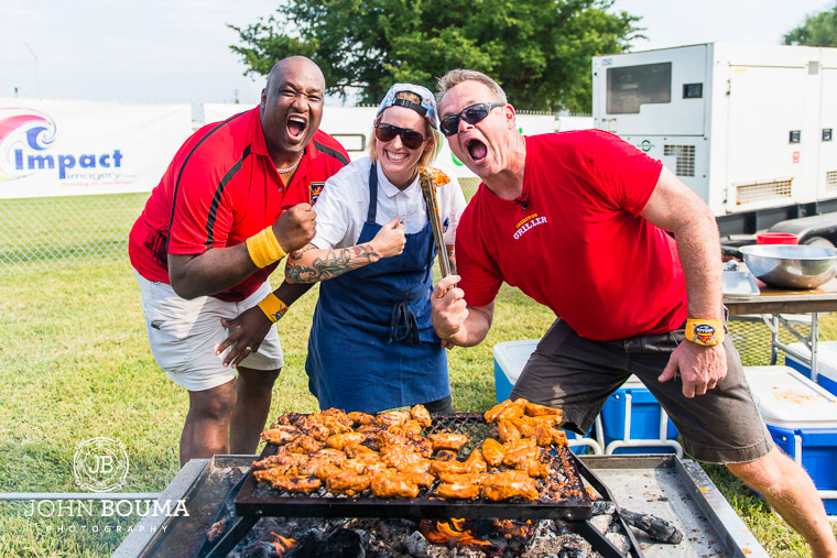 Keith Sims, Executive Chef Lauren Hills of Market 17 and John Offerdahl with Lauren's Smoked Maple Chili Chicken Wings.